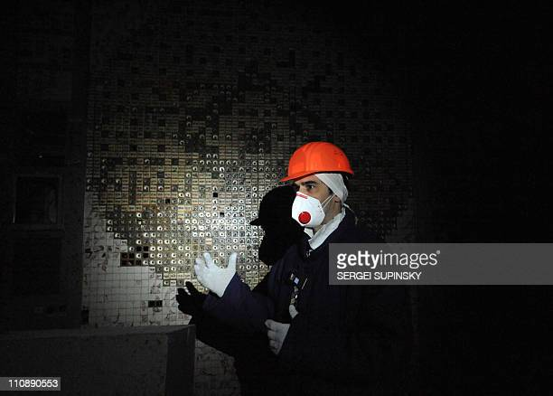 An employee of the Chernobyl Nuclear Power Plant walks in the control room of the destroyed 4th block of the plant on February 24, 2011 ahead of the...