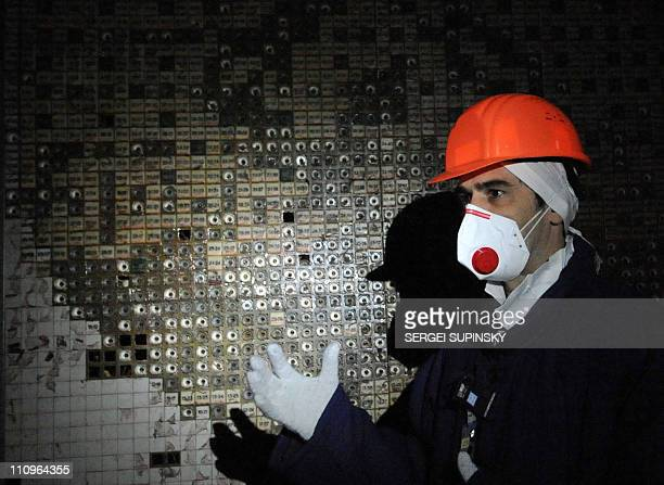 An employee of the Chernobyl Nuclear Power Plant walks in the control room of the destroyed 4th block of the plant on February 24 2011 ahead of the...