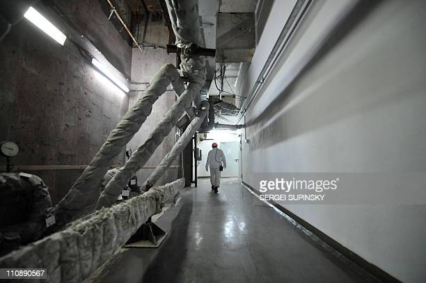 An employee of the Chernobyl Nuclear Power Plant walks the halls of the destroyed 4th block of the plant on February 24 2011 ahead of the 25th...