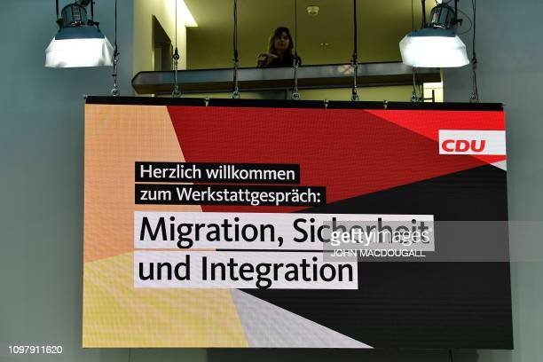 An employee of the Christian Democratic Union looks down during a seminar on migration in Berlin on February 11 2019