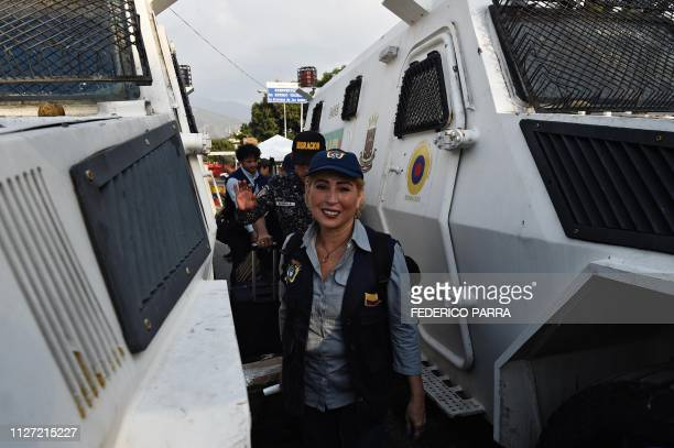 An employee of the Colombian Consulate in Valencia Venezuela walks followed by a Venezuelan migrations officer and the Colombian Consul in Merida...
