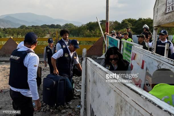An employee of the Colombian Consulate in Valencia Venezuela walks followed by the Colombian Consul in Merida Venezuela Carlos Garcia as they enter...