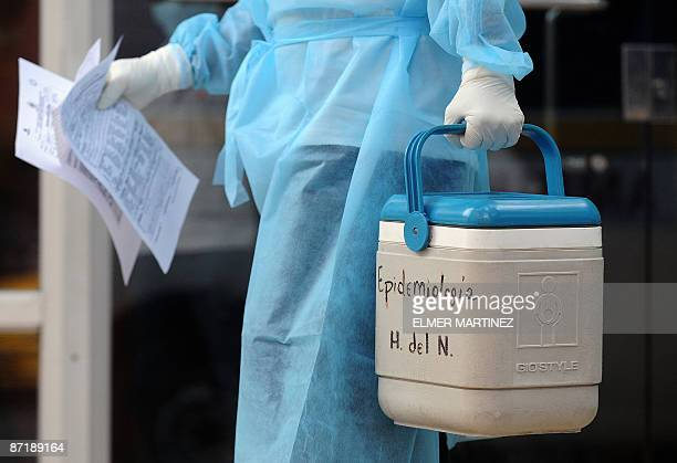An employee of the epidemiology ward of the Children Hospital where many swine flu virus Influenza A infected kids have been admitted walks out from...