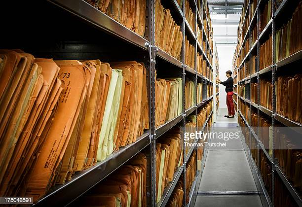 An employee of the federal archive views documents in the federal archive of the former East German secret police known as the Stasi on July 30 2013...
