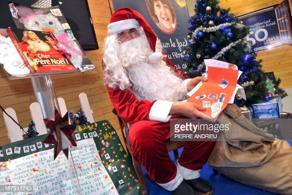 An Employee Of The French Postal Services La Poste Dressed As Santa