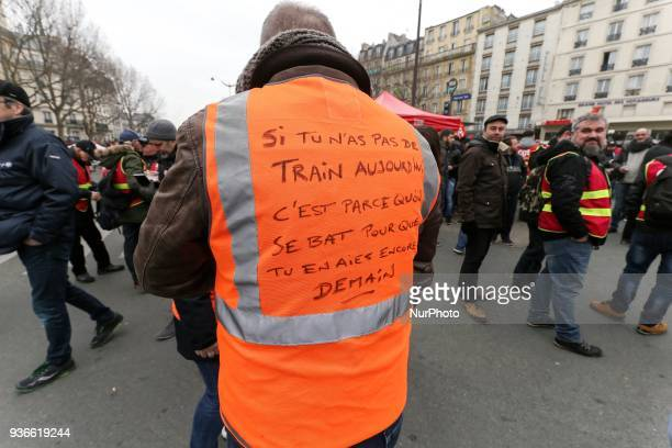 An employee of the French state owned railway company SNCF wearing a jacket reading « If you dont have a train today its because we fight for you...