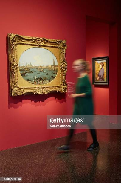 An employee of the gallery looking at the oil paintings 'Ansicht des Markusbeckens in Venedig' 1735 by Giovanni Antonio Canal and 'Bildnis Anna...