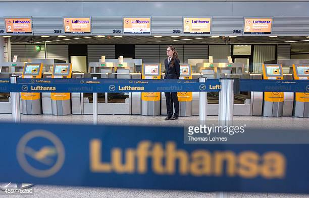 An employee of the German airline Lufthasa wait for empty Lufthansa counter at Frankfurt International Airport during a strike by Lufthansa pilots on...