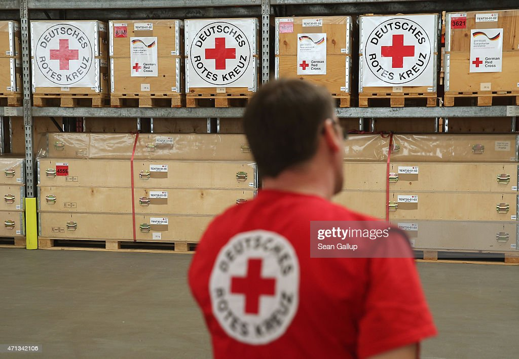 An Employee Of The German Red Cross Drk Stands In Organization S Warehouse For