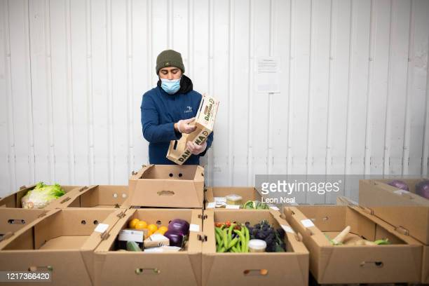 An employee of the highend fresh food wholesaler Natoora picks an order for home deliveries after the company decided to open up their customer list...