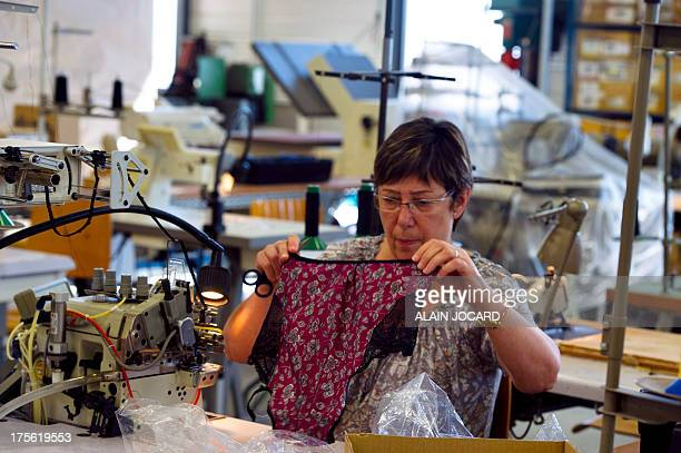 """An employee of the """"Indiscrete"""" lingerie brand manufactures panties on July 1, 2013 at the company's production site in Chauvigny, centralwestern..."""