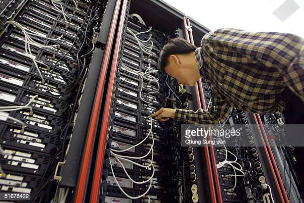 An employee of the Korea Institute of Science and Technology Information checks the supercomputers at the research institute November 5 2004 in...