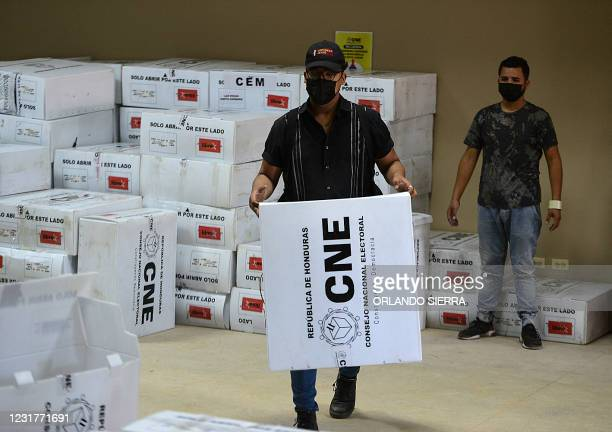An employee of the National Electoral Council carries electoral boxes in Tegucigalpa, on March 17, 2021. - The primary elections were held on Sunday,...