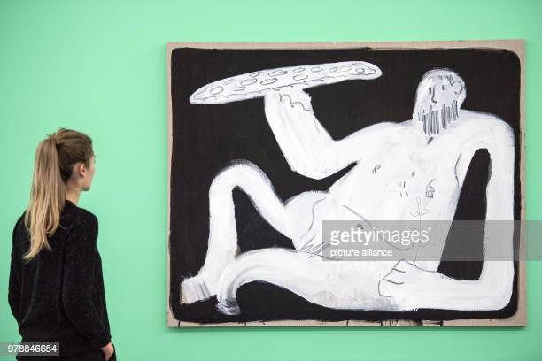 An employee of the NRWForum museum stands in front of the artwork 'Pizza God' by Spencer Sweeney from 2011 in Duesseldorf Germany 16 February 2018...