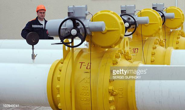 An employee of the Orlovka gascompressor station in the Izmail region near the UkrainianRomanian border makes a routine check on pipelines on January...