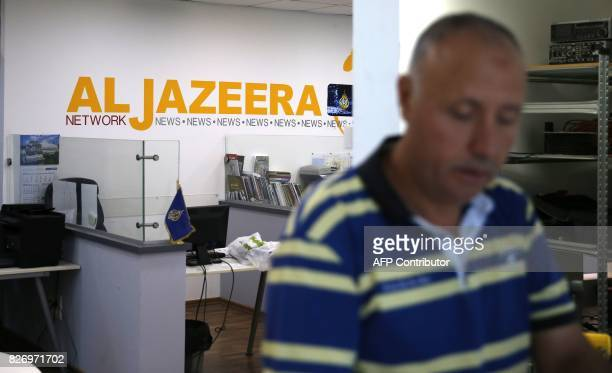 An employee of the Qatar based news network and TV channel AlJazeera is seen at the channel's Jerusalem office on July 31 2017 Israel said on August...