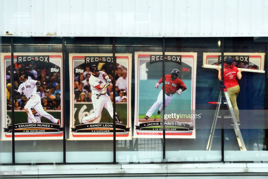 timeless design ed4a3 fc1d9 An employee of the Red Sox team store replaces a banner in ...