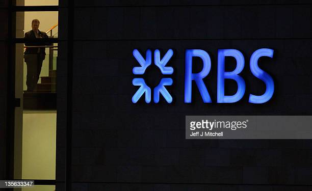 An employee of the Royal Bank of Scotland walks inside the company headquarters at Gogarburn on December 12 2011 in Edinburgh Scotland A Financial...