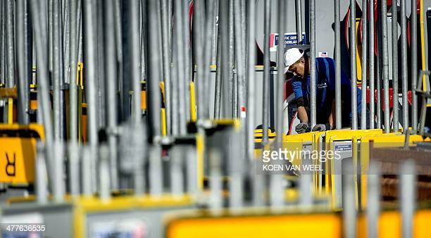 An employee of the Traffic Service Nederland works amid road signs for the Nuclear Security Summit 2014 in Badhoeverdorp, The Netherlands, on March...