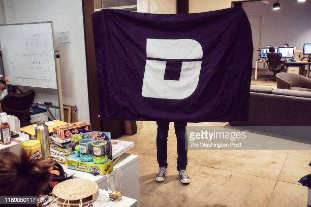 An employee of the website Deadspin shows a logo at their office in Manhattan New York on November 1 2018
