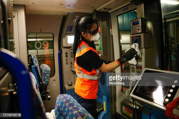 An employee of Transport for London cleans inside the driver's cabin during a deep clean operation of a train used on the Victoria Line of London...