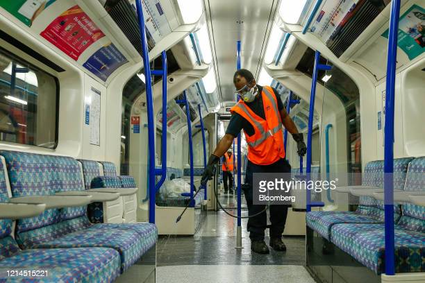 An employee of Transport for London prepares the floor for cleaning during a deep clean operation of a train used on the Victoria Line of London...