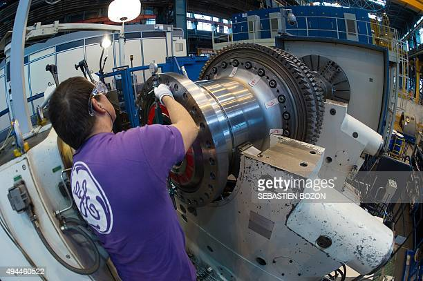 An employee of US multinational General Electric works on a gas turbine at the GE plant in Belfort eastern France on October 27 2015 AFP PHOTO /...