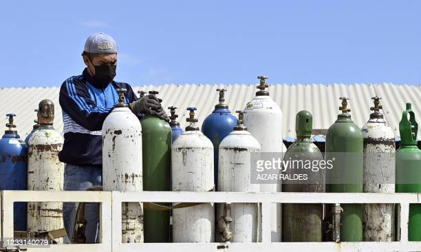 An employee of Valle Alto Medical Oxygen plant works with oxygen tanks in Arbieto municipality, 50 km from Cochabamba, on May 27, 2021.