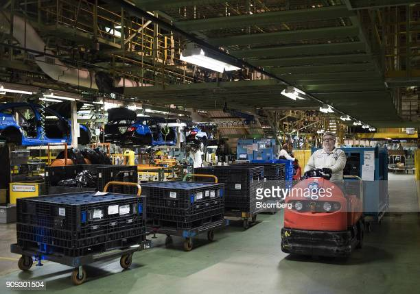 An employee omoves parts at the Honda of America Manufacturing Inc Marysville Auto Plant in Marysville Ohio US on Thursday Dec 21 2017 More than...