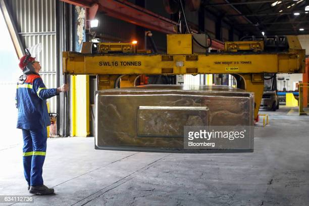 An employee operates a crane moving an aluminum ingot at the Lochaber aluminum smelter operated by Liberty House Group in Fort William UK on Monday...