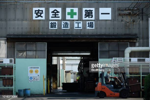 An employee operates a forklift truck at an Asahi Tekko Co factory in Nishio Aichi Prefecture Japan on Wednesday Aug 1 2018 Japan's government...