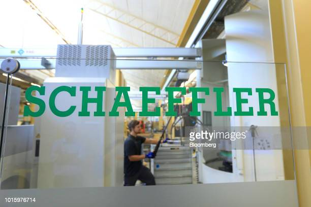 An employee operates a winch on the wind turbine bearing production line inside the Schaeffler AG machine tool 40 factory in Hoechstadt Germany on...
