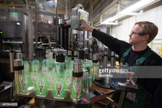 An employee operates automated bottle labelling machinery at the Heineken NV brewery in Saint Petersburg Russia on Wednesday Nov 18 2015 Heineken...