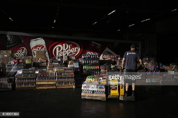An employee organizes delivery orders at the Dr Pepper Snapple Group Inc bottling plant in Irving Texas US on Tuesday Oct 25 2016 Dr Pepper Snapple...