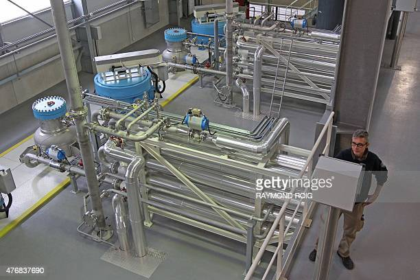 An employee oversees production on the new assembly line of the TCA taintfree corks at the Diam cork factory in Ceret south of Perpignan on June 12...
