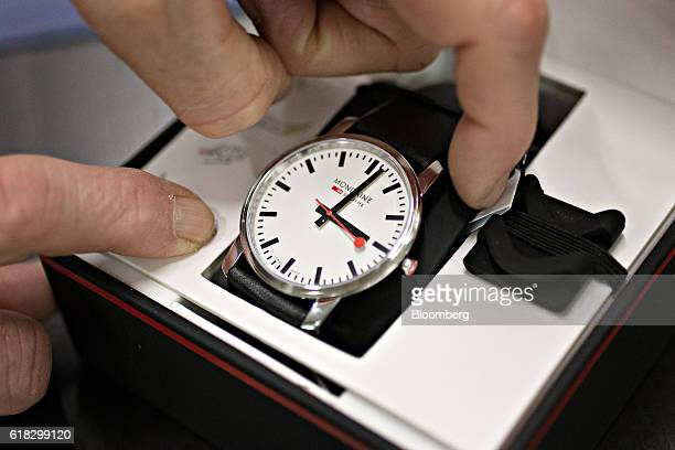 An employee packages a completed stop2go official Swiss Railways model wristwatch at the Mondaine Watch Ltd production facility in Solothurn...