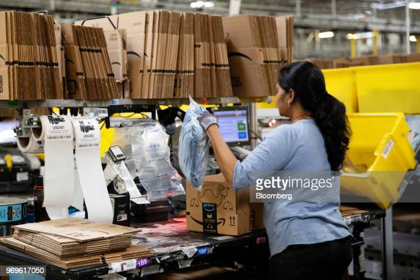 An employee packs a box at the Amazoncom Inc fulfillment center in Robbinsville New Jersey US on Thursday June 7 2018 Seattlebased Amazon hasn't yet...