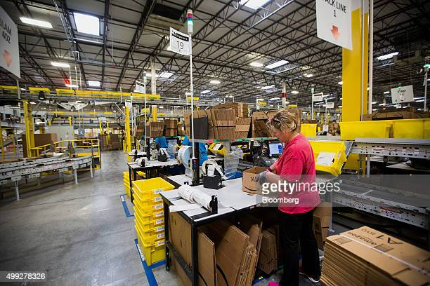 An employee packs a box at the Amazoncom Inc fulfillment center on Cyber Monday in Robbinsville New Jersey US on Monday Nov 30 2015 Online sales on...