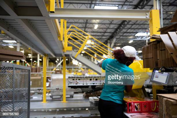 An employee packs an order at the Amazoncom Inc fulfillment center in Robbinsville New Jersey US on Thursday June 7 2018 Seattlebased Amazon hasn't...
