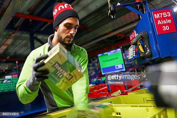 An employee packs an order at the Ocado Group Plc distribution centre in Dordon UK on Friday Dec 16 2016 Ocado provides home delivery of a wide range...