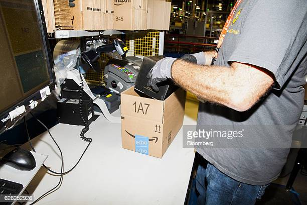 An employee packs an order inside an Amazoncom Inc fulfillment center in Robbinsville New Jersey US on Monday Nov 28 2016 In 2005 retailers coined...