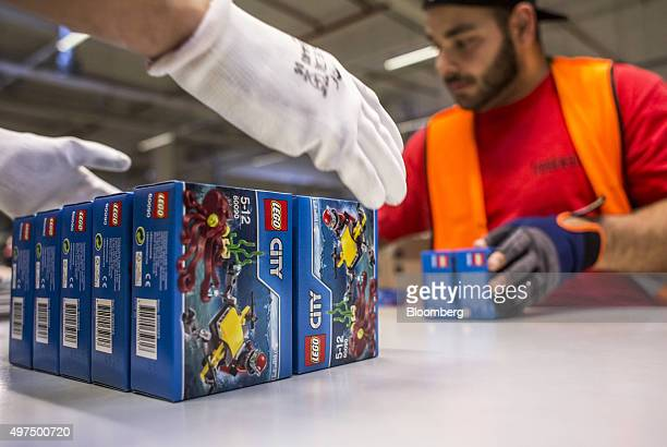An employee packs boxes containing toys from the 'Lego City' collection at the Lego A/S Factory in Kladno Czech Republic on Monday Nov 16 2015 Lego...