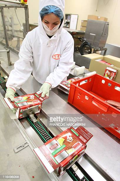An employee packs on June 16 the frozen ground beef on the production line at at the French company SEB in SaintDizier eastern France Six children...
