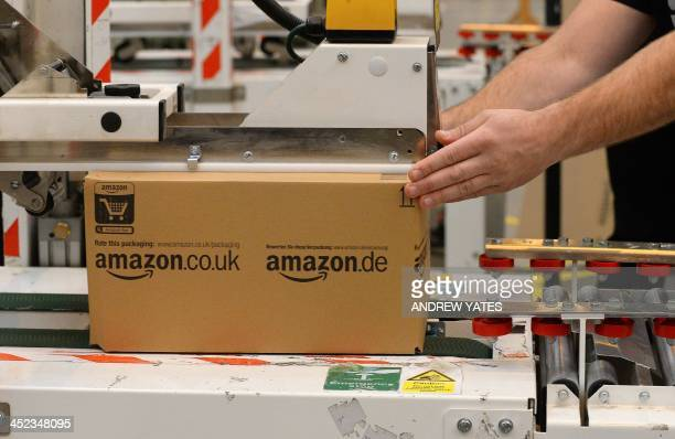 An employee packs orders in the Fulfilment Centre for online retail giant Amazon in Peterborough central England on November 28 ahead of Cyper Monday...