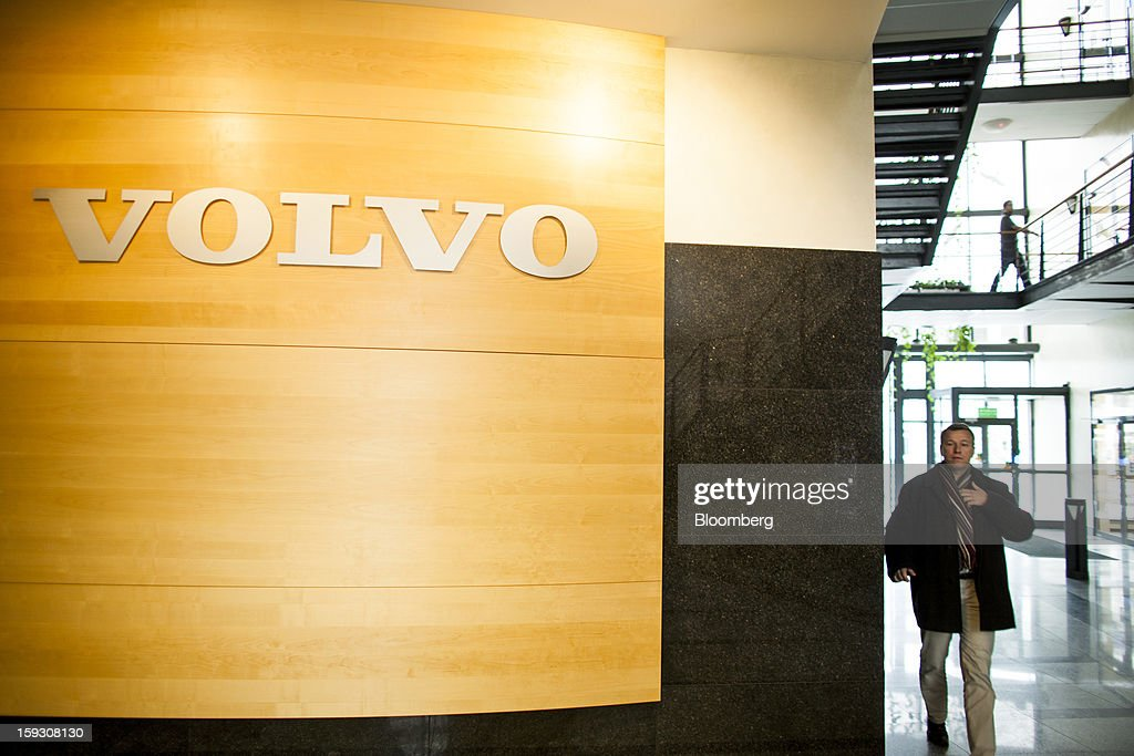 An employee passes a logo on a wall inside the offices of Volvo AB's bus manufacturing plant in Wroclaw, Poland, on Friday, Jan. 11, 2013. Volvo plans to end bus making in Saeffle by June 2013, and will consolidate the business in Europe to its main plant in Wroclaw, Poland, the Gothenburg, Sweden-based company said. Photographer: Bartek Sadowski/Bloomberg via Getty Images