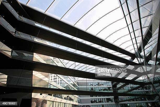 An employee passes along an elevated walkway inside the Adidas AG headquarters in Herzogenaurach Germany on Thursday May 15 2014 In May Adidas...