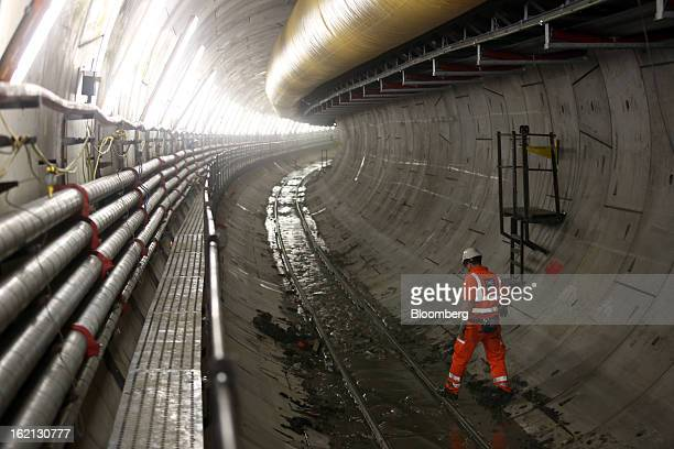 An employee passes along one of new western tunnels developed by Crossrail beneath London UK on Tuesday Feb 19 2013 Network Rail Ltd projects include...