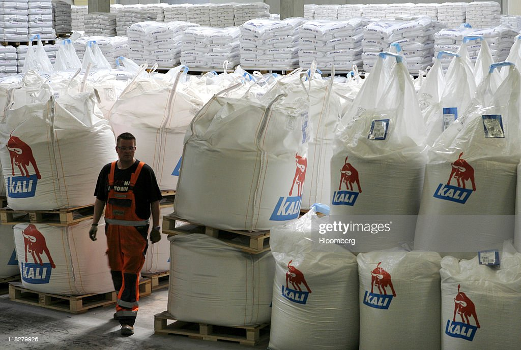 An employee passes K+S Kali GmbH branded sacks of potassium chloride, also known as potash, at the company's warehouse in Bebra, Germany, on Tuesday, July 5, 2011. K+S AG, Europe's biggest potash producer, dropped 1.3 percent to 53 euros and Yara International ASA, the largest maker of nitrogen fertilizers, slid 4.2 percent to 303.70 kroner as a U.S. Department of Agriculture report showed that U.S. grain acreage and inventories topped analysts' estimates. Photographer: Hannelore Foerster/Bloomberg via Getty Images