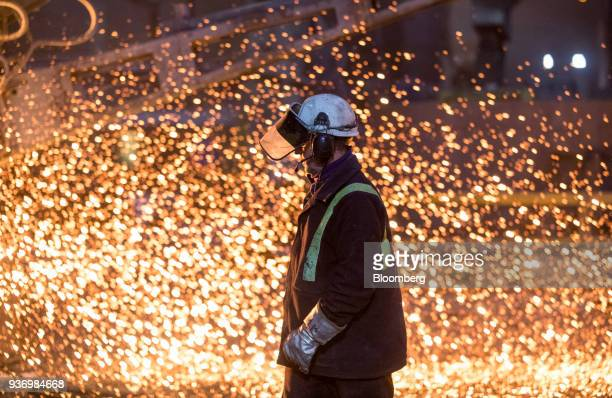 An employee passes the electric arc furnace at Liberty Steel's Aldewerke mill in Rotherham UK on Wednesday March 21 2018 Most metals slumped on the...