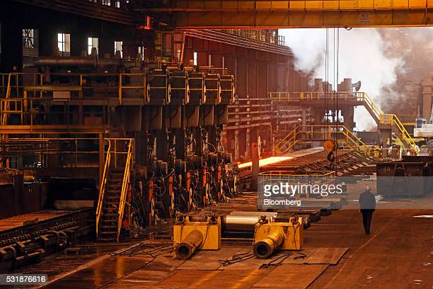 An employee passes the rolled coil finishing mill inside Liberty House Group's rolling steel mill in Newport UK on Tuesday May 17 2016 Liberty House...
